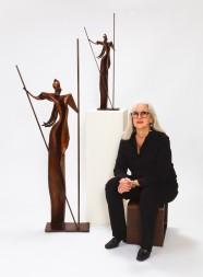 cheryl barnett with enlargement of v (for victorious) sculpture, 2018